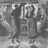 A man and a woman dancing in a group