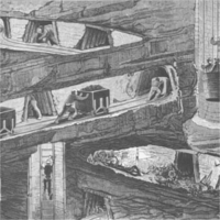 Figures working in a mine, pushing carts